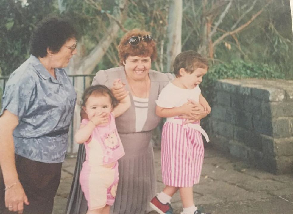 My dear Avó holding me, as 13 month old to her left and my older cousin Sandra to her right.